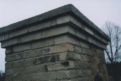 Silikat skorsten. Ommurad tre skift + gjuten krona av betong.